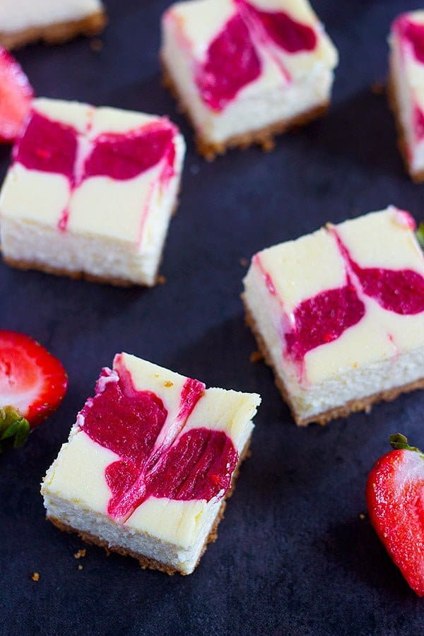 Strawberry Swirl Cheesecake Bars can be your easy, go to dessert recipe this summer. Everyone loves a creamy and luscious cheesecake topped with delicious homemade strawberry swirl.