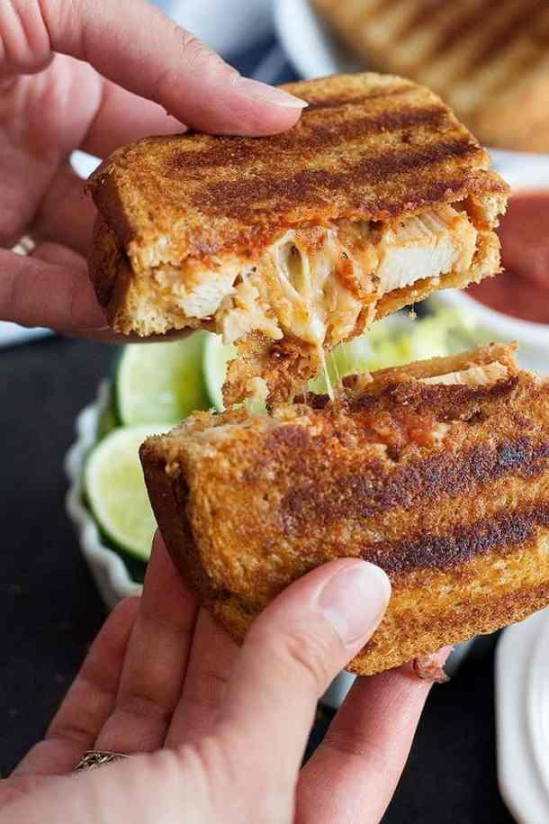 Chicken Parmesan Grilled Cheese Sandwich is the best of both worlds! Delicious chicken smothered in tomato sauce, pressed between two slices of bread with a lot of cheese!