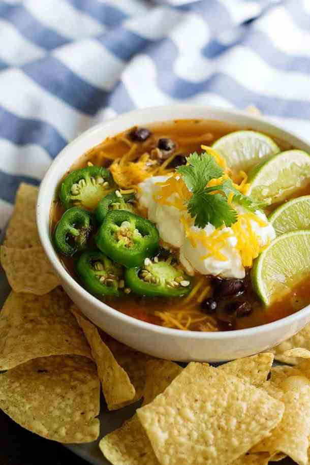 This healthy chicken tortilla soup is made with a handful of ingredients and can be made in the slow cooker, on the stove or in the instant pot.