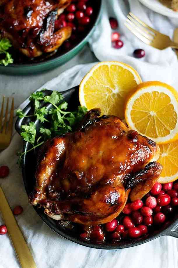These Cranberry Orange Glazed Cornish Hens are perfect for holiday family dinners. The flavors of cranberries and oranges make this festive dinner a winner!