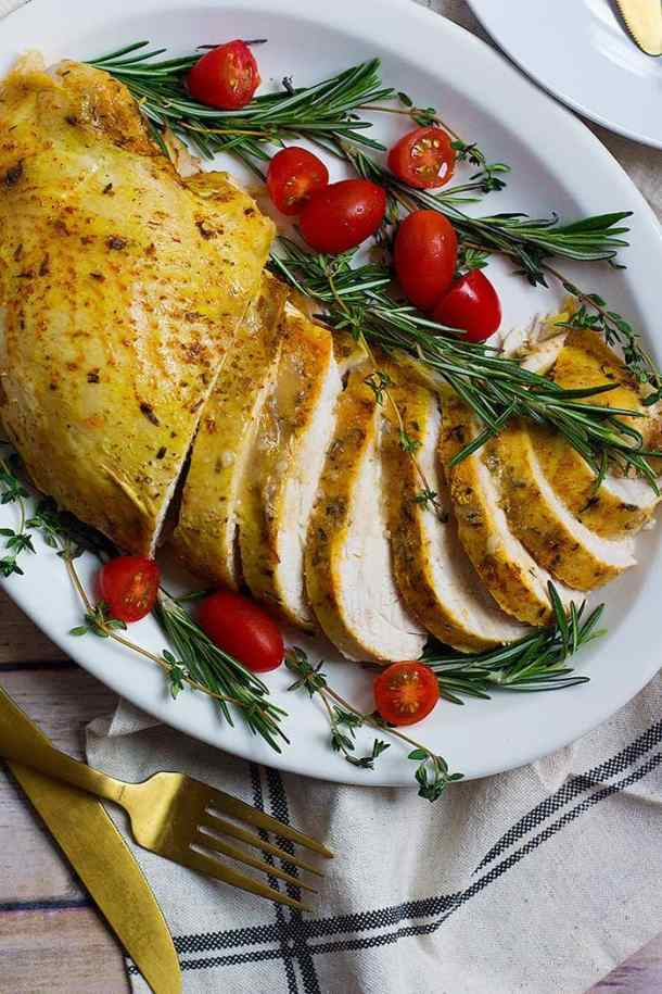 This slow cooker turkey breast recipe is simple method that will always give you juicy and moist turkey breast with minimal preparation. It's perfect for Thanksgiving and the holidays!
