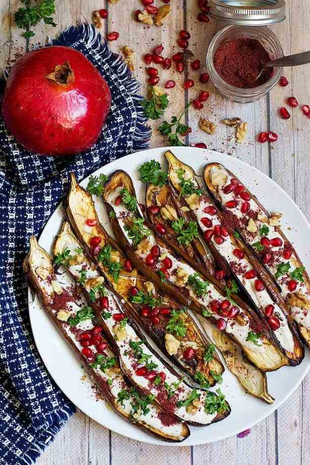 This is a Middle Eastern Eggplant Recipe to always have close at hand. It's served with a stunning tahini yogurt sauce and pomegranate arils, perfect as a side dish or an impressive appetizer!