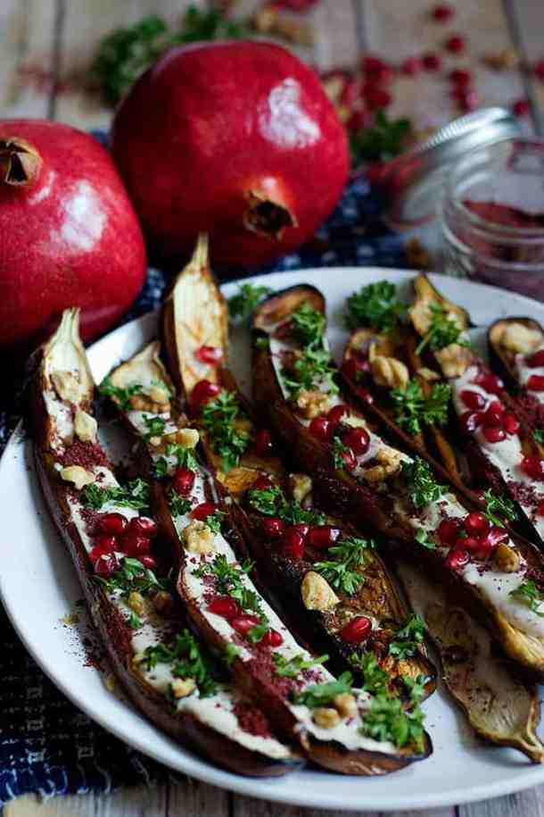 Oven Roasted Eggplant with sumac, yogurt tahini sauce, pomegranates and walnuts.