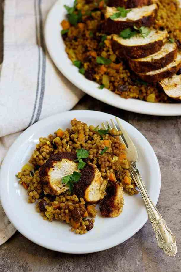 Moroccan chicken recipe with couscous served on a plate.