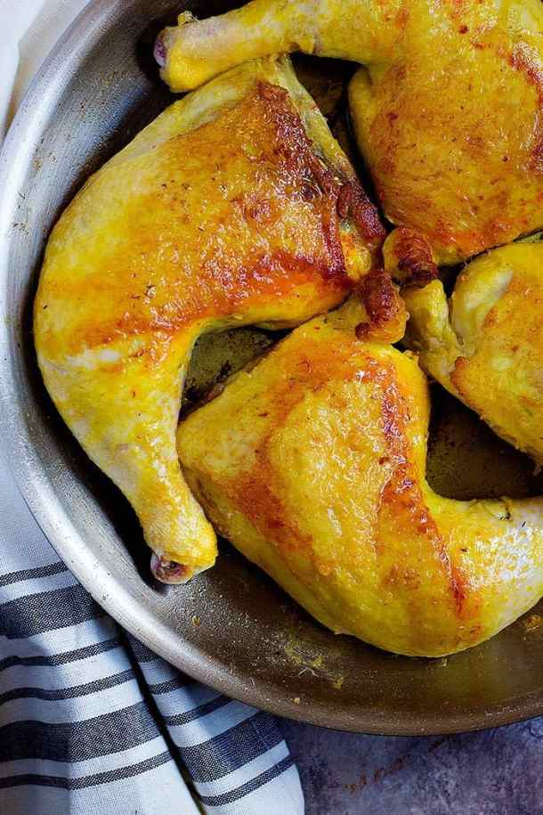 To make this Persian Chicken Recipe, sear the chicken thighs in a pan until the skin is golden.