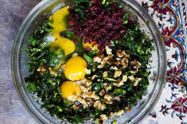 Mix all chopped herbs with eggs, walnuts and barberries. This will be the batter of kuku sabzi.