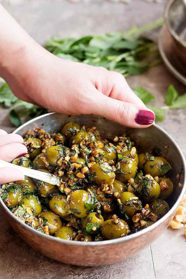 Serve marinated olives as an appetizer or side dish with different rice dishes.