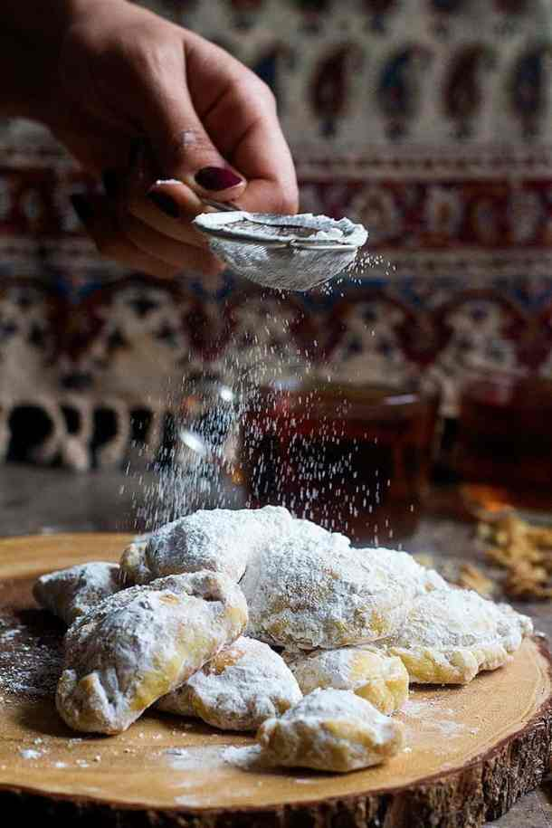 Qottab (Persian walnut filled pastry) these are traditional Persian pastries that are sweet and flaky, filled with a combination of walnuts, sugar and cardamom.