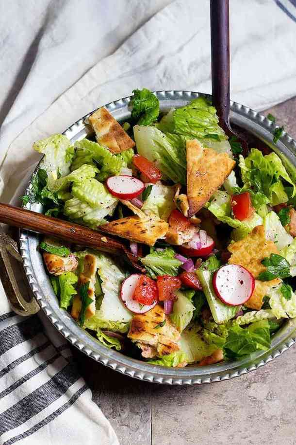 Fattoush is a Lebanese salad made with fresh lettuce, tomatoes and other veggies.