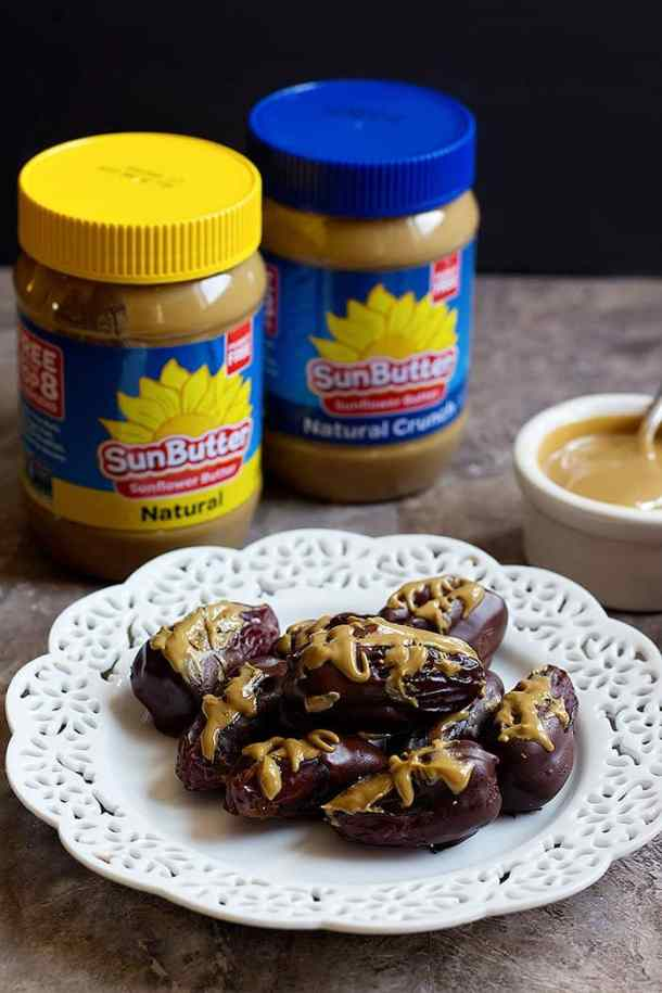 Drizzle More SunButter on the stuffed dates.