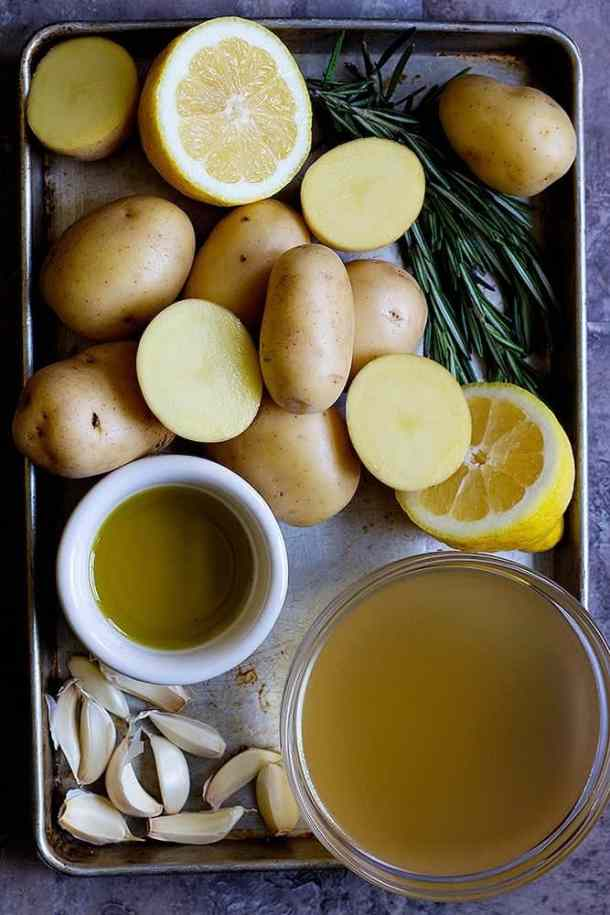 Greek potatoes recipe calls for potatoes, lemon, rosemary, olive oil, chicken broth and garlic