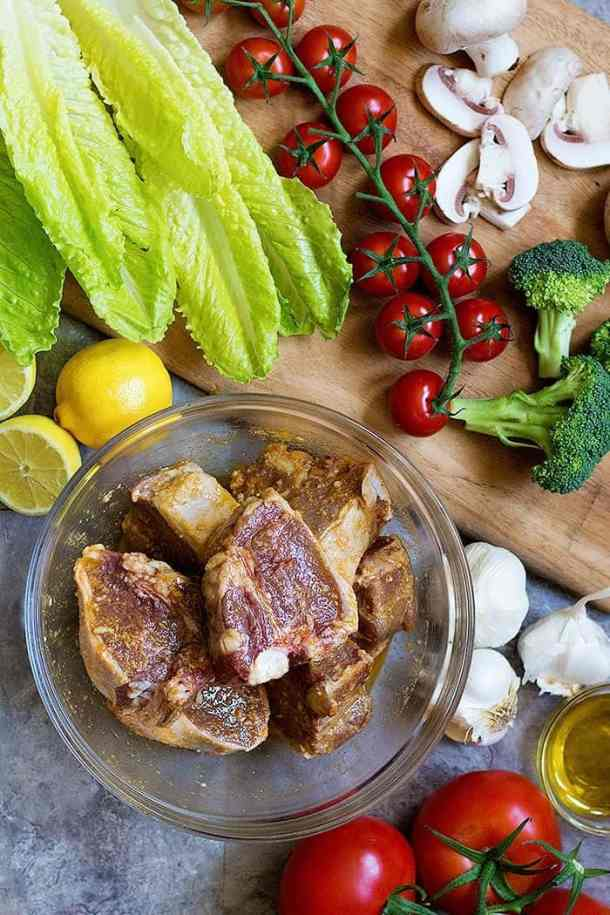 Marinate the lamb loin chops in an olive oil, herbs and garlic mixture.
