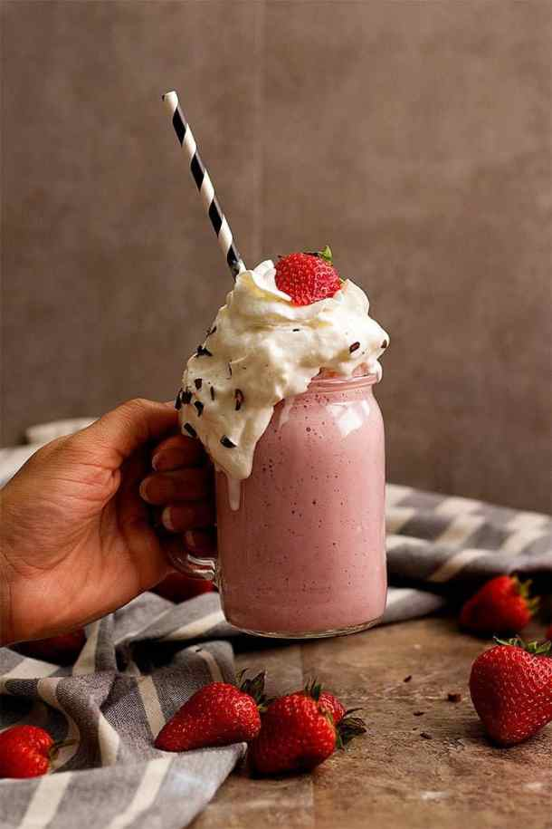how to make a strawberry milkshake with fresh strawberries and whipped cream.