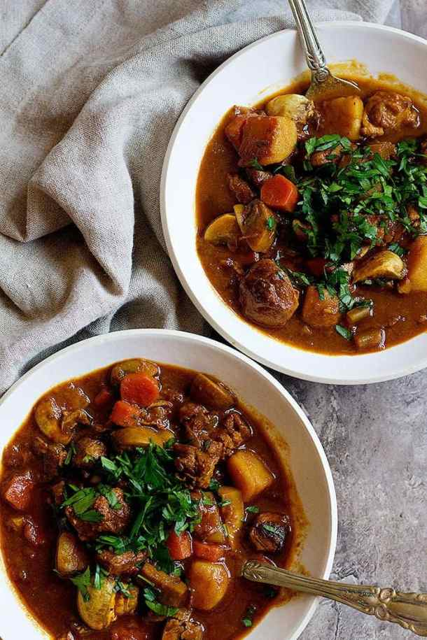 Top lamb stew with chopped parsley.