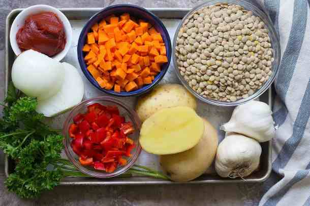 healthy lentil soup ingredients are lentils, carrots, onions, potatoes, garlic and spices.