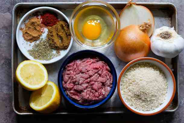 Greek meatballs are made of beef and lamb, egg, onion, bread crumbs, garlic, lemon and spices.