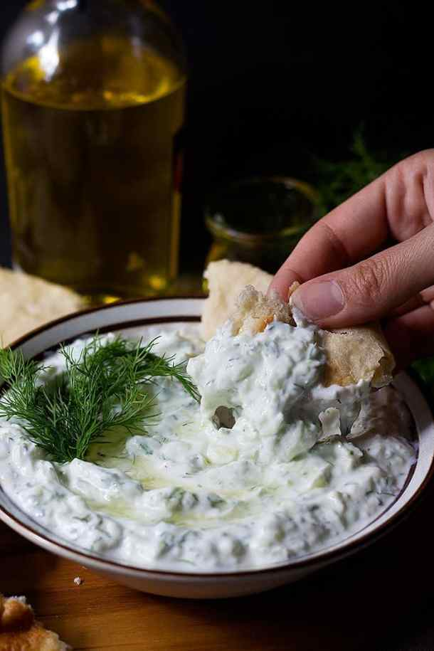 Homemade tzatziki sauce is perfect with some fresh pita bread as an appetizer.