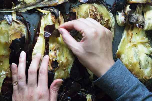 One the eggplant is roasted, peel the skin.