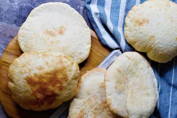 This homemade pita bread recipe is easy and makes eight pitas.