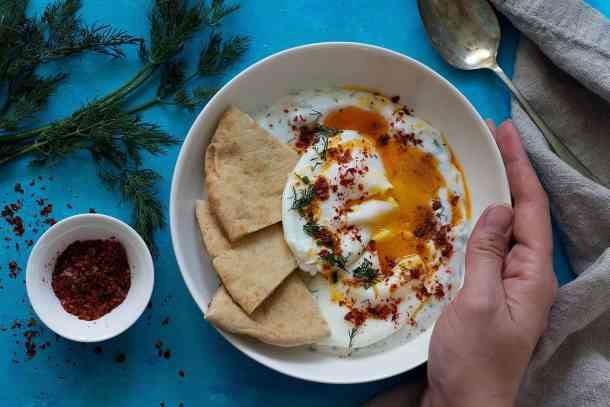 Cilbir is a complete dish on it's own. However, I always enjoy a slice of toasted bread like sourdough with it. Turkish eggs can also be served with warm lavash or pita bread.