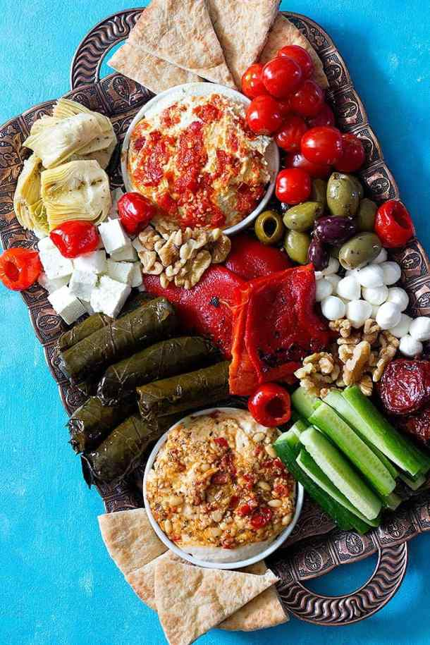 Mezze platter is great for entertaining. You can make it with hummus, dolma, olives and feta cheese.