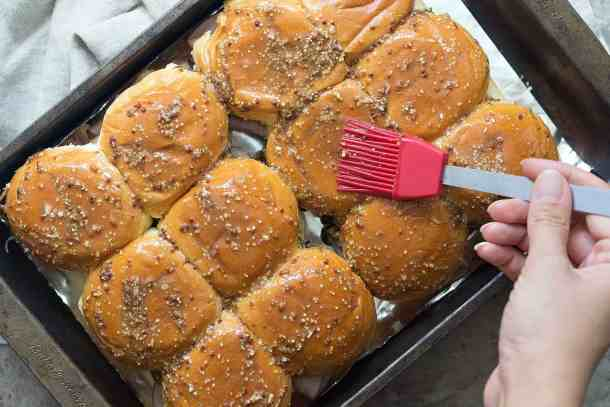 Brush the melted butter spread on the Hawaiian rolls, cover with aluminum foil and bake in the oven. Bake uncovered for some minutes, cut and serve immediately.