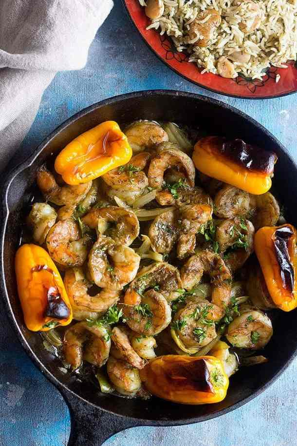Baked shrimp is one of the easiest recipes out there. Turn it into a delicious meal using Moroccan chermoula sauce and serve with dill rice.