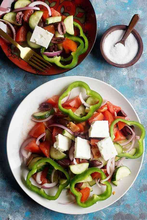 Learn how to make traditional Greek salad recipe with only a few ingredients. This easy and simple summer salad comes together in no time!