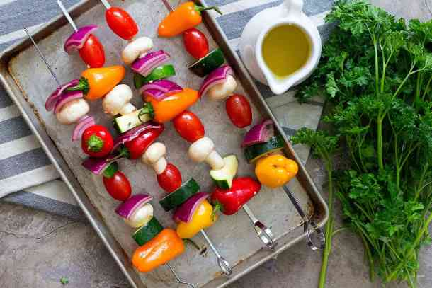 Thread the veggies on skewers and start grilling.