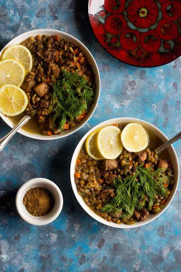 Serve chicken lentil soup with fresh dill and lemon.