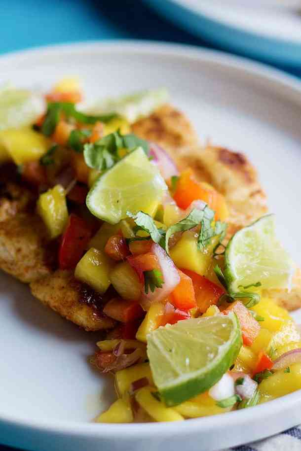 Alaska Grilled halibut is topped with a homemade mango salsa