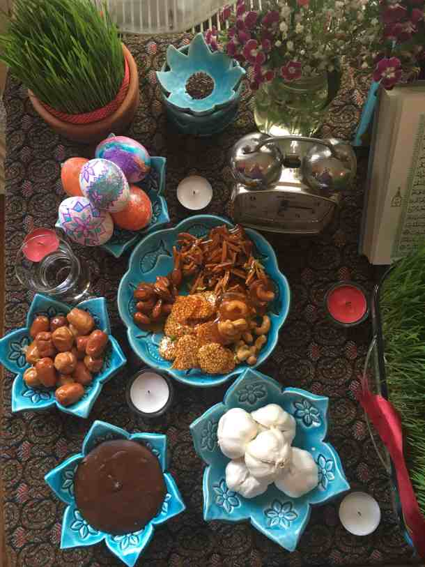For Persian new year we set a table called haftseen. there are sweets, garlic and fruit on the table.