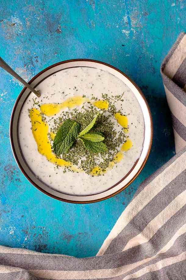 cacik in a bowl with dried mint fresh mint and olive oil