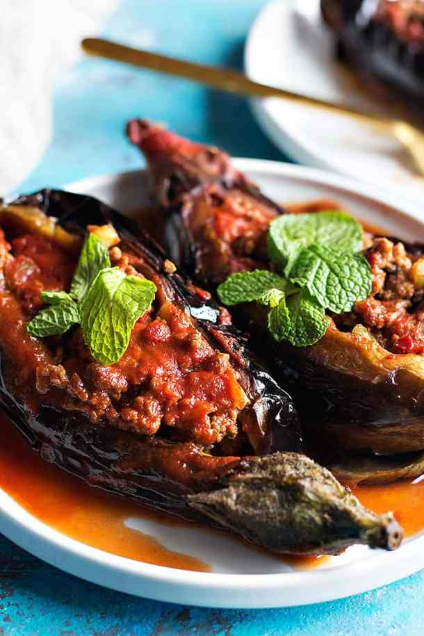 Karniyarik is a classic Turkish stuffed eggplant recipe. Delicious eggplants are stuffed with a tasty ground beef, pepper and tomatoes filling and are baked to perfection.