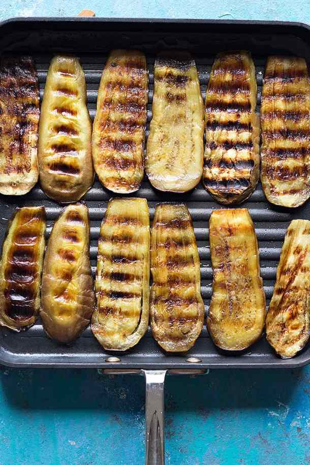 Grill eggplants on a grill pan on both sides.