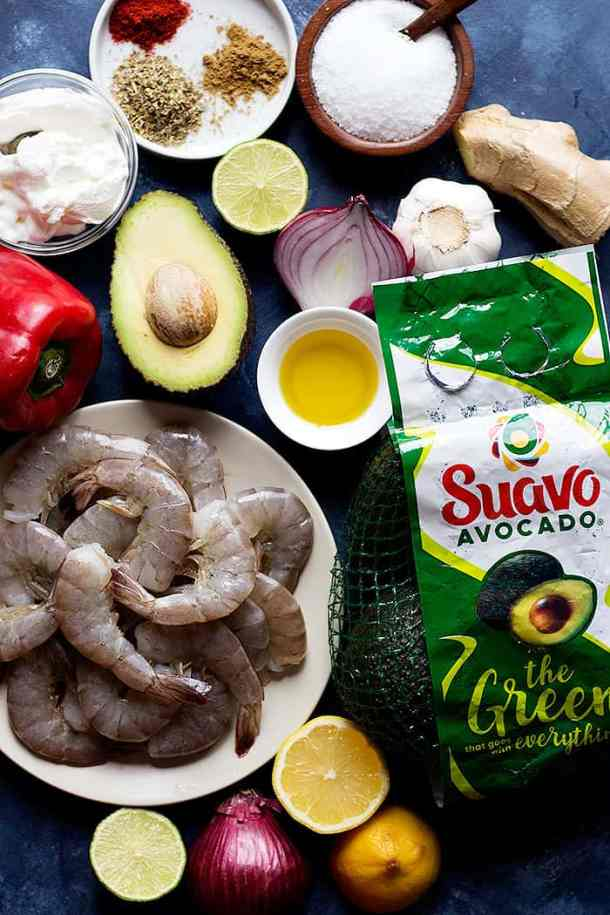 ingredients for shrimp kabob recipe are shrimp, spices, olive oil, avocado, yogurt, lemon, lime, ginger and garlic.