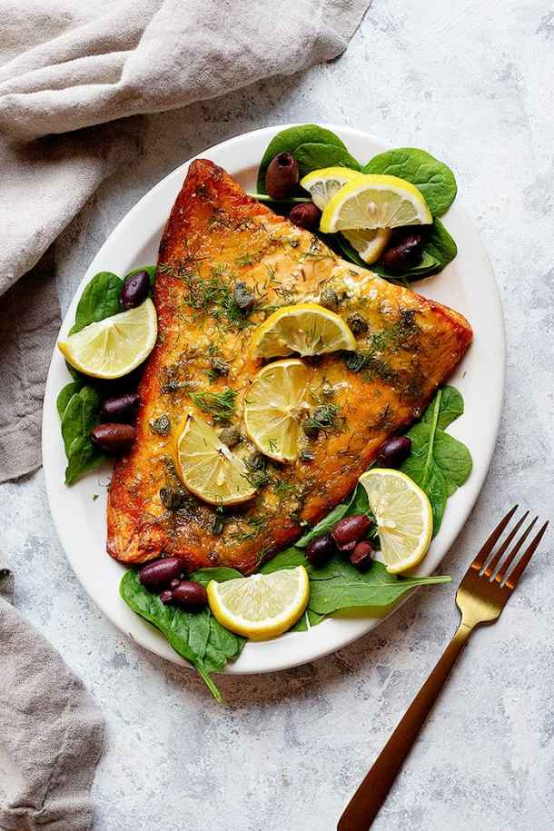 Serve baked dijon salmon with lemon and olives