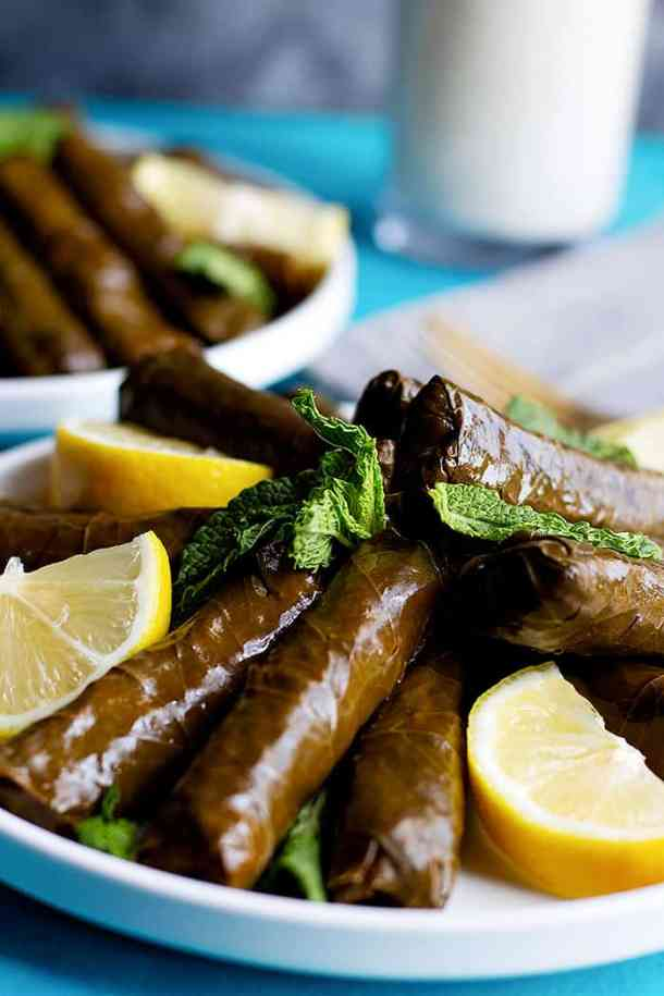Mediterranean dolmas are rolled into cigar shapes. They are cooked with oil and water.