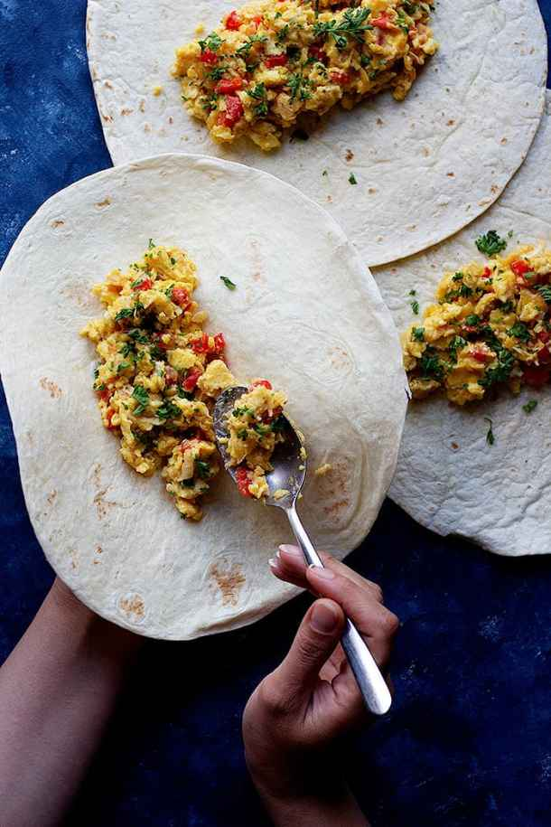 fill the tortillas with eggs and veggies and roll them