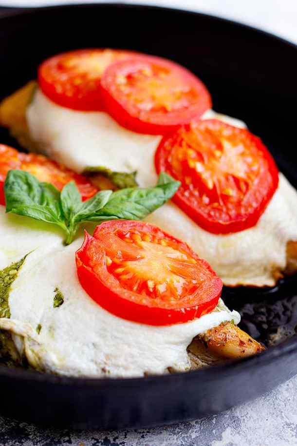 Here's an easy caprese chicken recipe that's ready in only 30 minutes. Made with fresh tomatoes, mozzarella and pesto, this is a delicious easy weeknight dinner. Learn how to make this easy chicken recipe at home with our video and step-by-step tutorial.