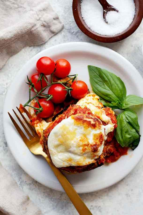 This eggplant parmesan recipe is a classic for good reasons. You can't go wrong with layers of eggplant, cheese and marinara sauce. Learn how to make this eggplant casserole with this easy tutorial (including a special tip that makes this dish special!) and how-to video.