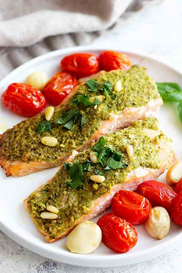 Baked salmon fillets with pesto, basil and pine nuts.