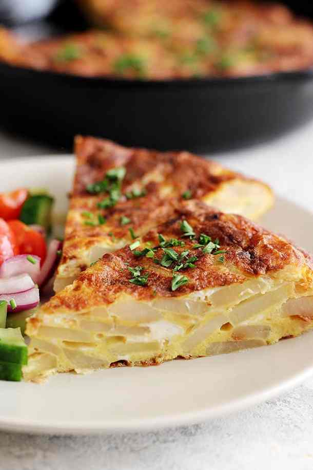 Spanish tortilla recipe is easy and very tasty. The slices show the potatoes beautifully.