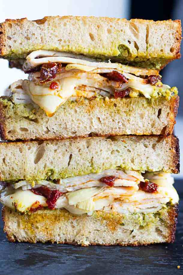 Turkey pesto panini sliced in half and stacked.