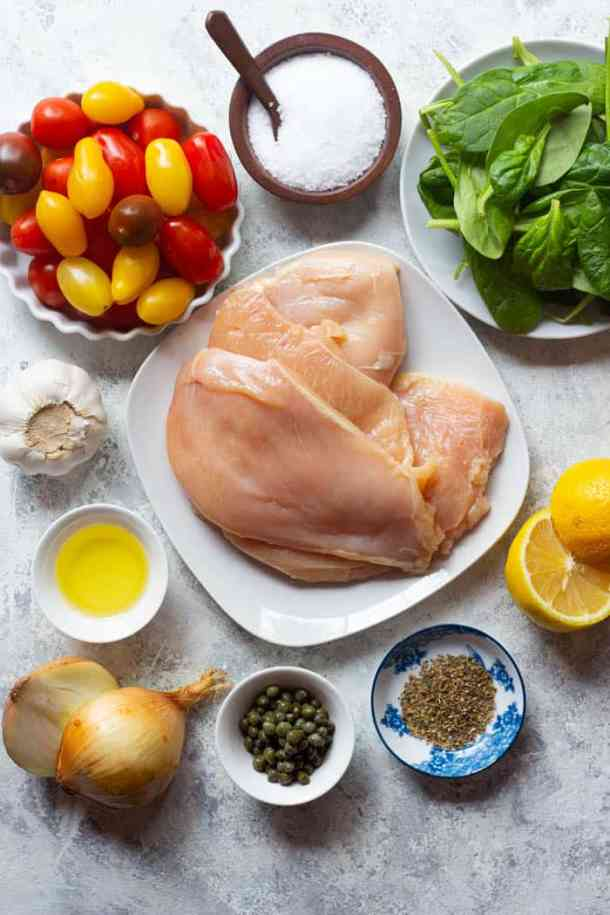 To make this recipe you need chicken breast, olive oil, spices, tomatoes, spinach and lemon.