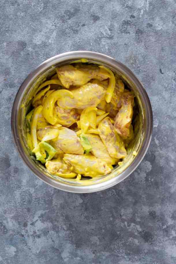 The chicken wings are marinated in a saffron yogurt mixture which will also make them very tender.