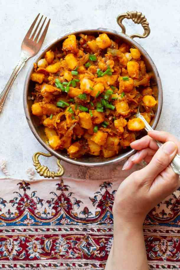 A plate of fried potatoes and onions made Persian style.