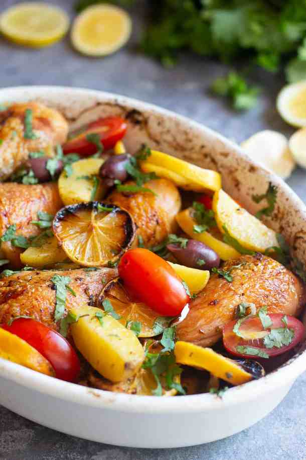 Close-up shot of Greek chicken and potatoes.