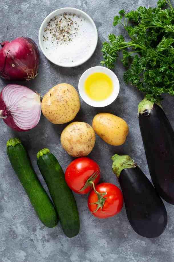 To make Greek briam, you need onion, salt and pepper, tomatoes, potatoes, eggplant, zucchini and olive oil.