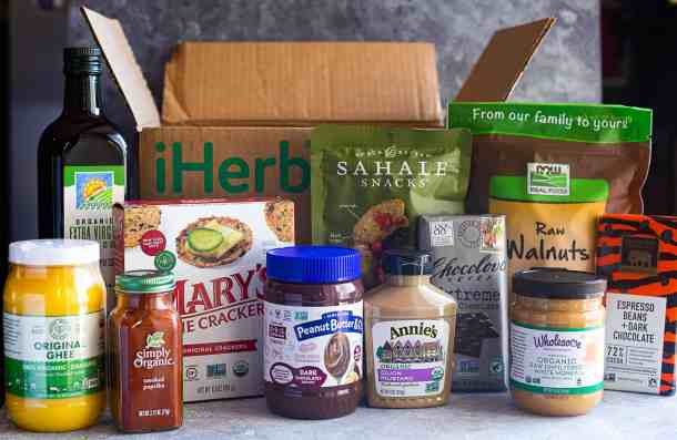 iHerb haul. Different products such as ghee, paprika, chocolate, dijon, peanut butter, crackers, olive oil, honey and walnuts.